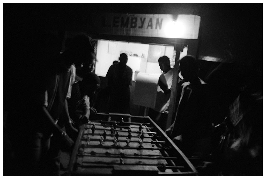 young men playing tabletop football